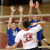 Methuen's Jake Branchaud, left, and Tim Galloway-Burke leap to block a spike attempt by Central Catholic's Nick Boes.