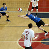 Methuen's Jake Branchaud dives to bump the ball.