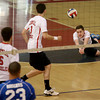 Central Catholic's Austin Corrieri dives for the ball during their volleyball match.