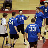 Methuen players celebrate a point late in the fifth and final game of their volleyball match against Central Catholic.
