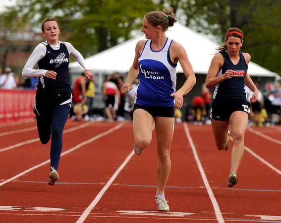 """Lyons High School's Rachel Hinker, center, checks the other runners before crossing the finish line in 1st place in the girls class 2A 100-meter dash during the 2011 Colorado State Track and Field Championships on Saturday, May 21, at Jeffco Stadium in Lakewood. For more photos go to  <a href=""""http://www.dailycamera.com"""">http://www.dailycamera.com</a><br /> Jeremy Papasso/ Camera"""