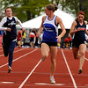 "Lyons High School's Rachel Hinker, center, checks the other runners before crossing the finish line in 1st place in the girls class 2A 100-meter dash during the 2011 Colorado State Track and Field Championships on Saturday, May 21, at Jeffco Stadium in Lakewood. For more photos go to  <a href=""http://www.dailycamera.com"">http://www.dailycamera.com</a><br /> Jeremy Papasso/ Camera"