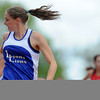 20110521_TROY_STATE_LG_HINKER.JPG Lyons' Rachel Hinker checks the competition while nearing the finish line of the 200 meter dash during the State Track and Field Championships Saturday May 21, 2011 at Jefferson County Stadium. (Lewis Geyer/Times-Call)