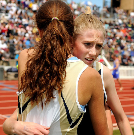 "Nederland High School junior Kelley Robinson, right, gets a hug from teammate Rebecca Hermann after winning the girls class 2A 1600-meter run during the 2011 Colorado State Track and Field Championships on Saturday, May 21, at Jeffco Stadium in Lakewood. For more photos go to  <a href=""http://www.dailycamera.com"">http://www.dailycamera.com</a><br /> Jeremy Papasso/ Camera"