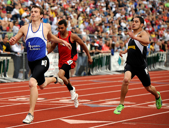 "Lyons High School's Forrest Donnell, left, crosses the finish line in 2nd place in the boys class 2A 100-meter dash during the 2011 Colorado State Track and Field Championships on Saturday, May 21, at Jeffco Stadium in Lakewood. For more photos go to  <a href=""http://www.dailycamera.com"">http://www.dailycamera.com</a><br /> Jeremy Papasso/ Camera"