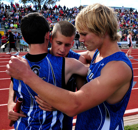 20110521_TROL_STATE_JB_EHRMANTRAUT_HITCHCOCK_WETTERSTROM.JPG Longmont's Josh Ehrmantraut, center, is hugged by Braden Hitchcock, left, and Forrest Wetterstrom after they placed second in the 4x400 relay during the State Track and Field Championships Saturday May 21, 2011 at Jefferson County Stadium. (Joshua Buck/Times-Call)