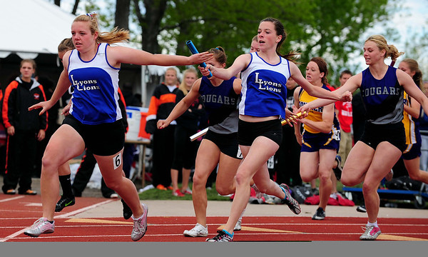 20110521_TROY_STATE_JB_HICKEY_ARLING.JPG Lyons' Michelle Hickey, left, takes the baton from Dana Arling during the 4x100 relay during the State Track and Field Championships Saturday May 21, 2011 at Jefferson County Stadium. (Joshua Buck/Times-Call)