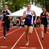 "Lyons High School's Rachel Hinker, center, crosses the finish line in 1st place after winning the girls class 2A 100-meter dash during the 2011 Colorado State Track and Field Championships on Saturday, May 21, at Jeffco Stadium in Lakewood. For more photos go to  <a href=""http://www.dailycamera.com"">http://www.dailycamera.com</a><br /> Jeremy Papasso/ Camera"