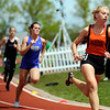 "Erie High School's Madeline Anderson, right, speeds around the track while racing in the girls class  4A 400-meter dash during the 2011 Colorado State Track and Field Championships on Saturday, May 21, at Jeffco Stadium in Lakewood. For more photos go to  <a href=""http://www.dailycamera.com"">http://www.dailycamera.com</a><br /> Jeremy Papasso/ Camera"