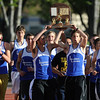20110521_TRO_STATE_LYONS_TROPHY_LG.JPG The Lyons boys take their team trophy for a celebratory lap around the track after winning the 2A State Track and Field Championships Saturday May 21, 2011 at Jefferson County Stadium. (Lewis Geyer/Times-Call)