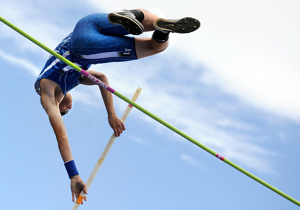 "Longmont High School junior Steven Wacker clears the mark in the boys class 4A pole vault during the 2011 Colorado State Track and Field Championships on Saturday, May 21, at Jeffco Stadium in Lakewood. For more photos go to  <a href=""http://www.dailycamera.com"">http://www.dailycamera.com</a><br /> Jeremy Papasso/ Camera"