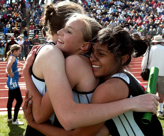 20110521_TRON_STATE_JB_TRAXINGER_MAYDEW_ENRIQUEZ.JPG Niwot's Kelsey Traxinger, left, is hugged by Dana Maydew, center, and Deyja Enriquez after finishing third in the 4x400 meter relay during the State Track and Field Championships Saturday May 21, 2011 at Jefferson County Stadium. (Joshua Buck/Times-Call)