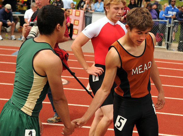 """Mead High School's Alex Mead, right, gets congratulated by another runner after winning the boys class 3A 100-meter dash during the 2011 Colorado State Track and Field Championships on Saturday, May 21, at Jeffco Stadium in Lakewood. For more photos go to  <a href=""""http://www.dailycamera.com"""">http://www.dailycamera.com</a><br /> Jeremy Papasso/ Camera"""