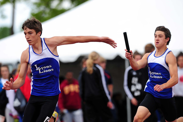 20110521_TROY_STATE_JB_RADSCH_TRIFFET.JPG Lyons' Matthew Radsch, left, is set to take the baton from Anthony Triffet in the 4x100 relay during the State Track and Field Championships Saturday May 21, 2011 at Jefferson County Stadium. (Joshua Buck/Times-Call)