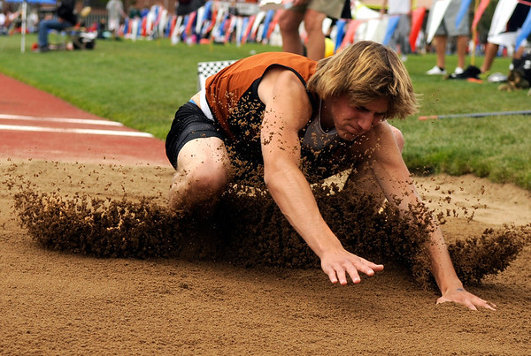 "Mead High School's Jared Hernandez lands hard in the sand after his jump while competing in the boys class 3A long jump during the 2011 Colorado State Track and Field Championships on Saturday, May 21, at Jeffco Stadium in Lakewood. For more photos go to  <a href=""http://www.dailycamera.com"">http://www.dailycamera.com</a><br /> Jeremy Papasso/ Camera"