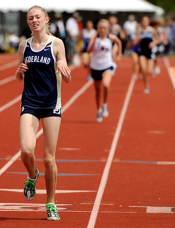 "Nederland High School junior Kelley Robinson crosses the finish line in 1st place in the girls class 2A 1600-meter run during the 2011 Colorado State Track and Field Championships on Saturday, May 21, at Jeffco Stadium in Lakewood. For more photos go to  <a href=""http://www.dailycamera.com"">http://www.dailycamera.com</a><br /> Jeremy Papasso/ Camera"