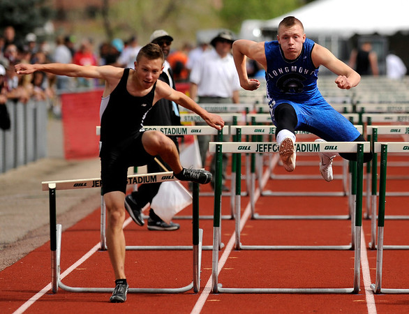"Longmont High School's Josh Cogdill, right, hustles over the hurdles in the boys class 4A 110-meter hurdles during the 2011 Colorado State Track and Field Championships on Saturday, May 21, at Jeffco Stadium in Lakewood. Cogdill finished in 6th place. For more photos go to  <a href=""http://www.dailycamera.com"">http://www.dailycamera.com</a><br /> Jeremy Papasso/ Camera"