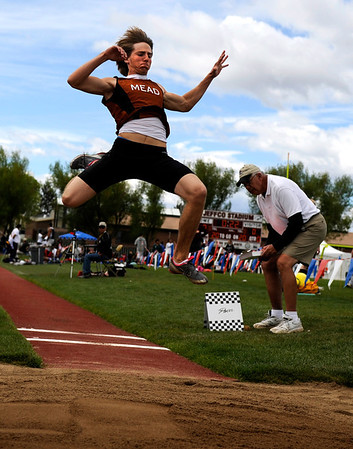 "Mead High School's Jared Hernandez flies through the air while competing in the boys class 3A long jump during the 2011 Colorado State Track and Field Championships on Saturday, May 21, at Jeffco Stadium in Lakewood. For more photos go to  <a href=""http://www.dailycamera.com"">http://www.dailycamera.com</a><br /> Jeremy Papasso/ Camera"