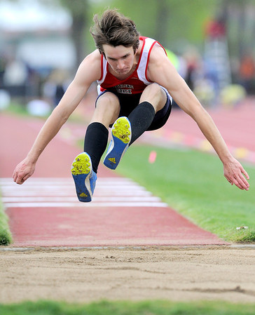 Skyline's Michael Seaman stretches as he lands in the sand for the triple jump during the State Track and Field Championships at Jefferson County Stadium in Lakewood, Colorado May 19, 2011.  CAMERA/Mark Leffingwell
