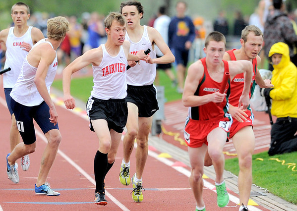 Fairview's Kyle Krahenbuhl (left) takes the baton from Kevin Hale (right) for the last leg of the Men's 4x800 during the State Track and Field Championships at Jefferson County Stadium in Lakewood, Colorado May 19, 2011.  CAMERA/Mark Leffingwell