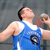 Longmont's Justin Hansen pushes upward as he releases the shot put during the State Track and Field Championships at Jefferson County Stadium in Lakewood, Colorado May 19, 2011.  CAMERA/Mark Leffingwell