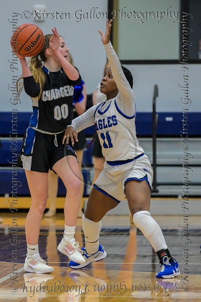 #00 Dallas CHS guard Kennedy Chappell tries to find room to pass around the defense of #11 SWCHS guard Ariele Rosborough.<br />  Southwest Christian HS girls basketball vs. Dallas Christian HS girls basketball in the TAPPS 5A semifinals, March 9, 2021