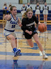 #00 Dallas CHS guard Kennedy Chappell drives the lane against the defense of #12 SWCHS guard Haylee Davis. Southwest Christian HS girls basketball vs. Dallas Christian HS girls basketball in the TAPPS 5A semifinals, March 9, 2021
