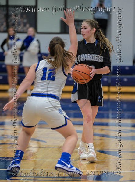 #00 Kennedy Chappell looks to make a pass agent the defense of #12 SWCHS guard Haylee Davis.<br /> Southwest Christian HS girls basketball vs. Dallas Christian HS girls basketball in the TAPPS 5A semifinals, March 9, 2021