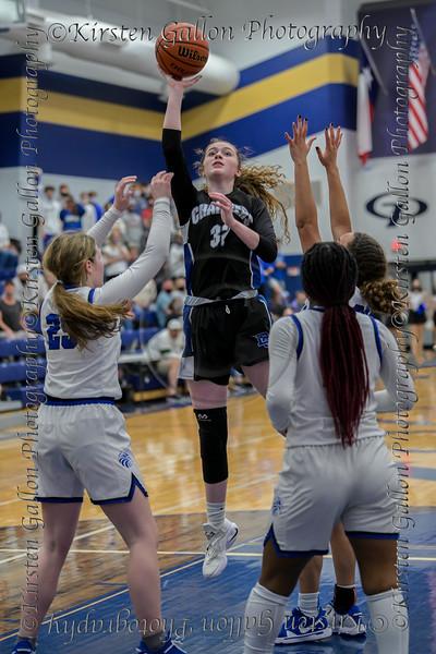 #32 Dallas CHS forward Caitlynn Jordan lets go of a jumper in traffic in the paint. <br /> Southwest Christian HS girls basketball vs. Dallas Christian HS girls basketball in the TAPPS 5A semifinals, March 9, 2021
