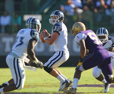 Jackson State quarterback Clayton Moore looks to pass as Alcorn defenders close in.