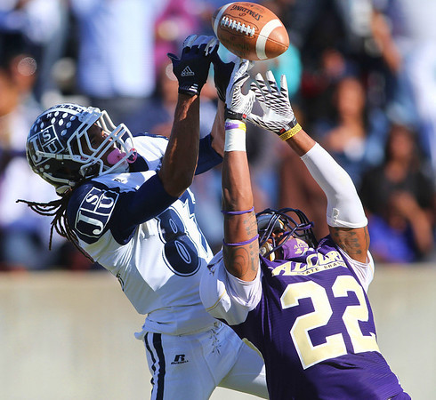 Jackson State receiver Rico Richardson attempts to haul in a pass over Alcorn defender Jamison Knox.