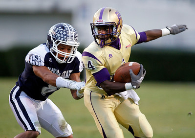 Alcorn receiver Billy Shed hauls in a pass as Jackson State's Travis Woods attempts to bring him down. (Charles A. Smith/For the Clarion Ledger)
