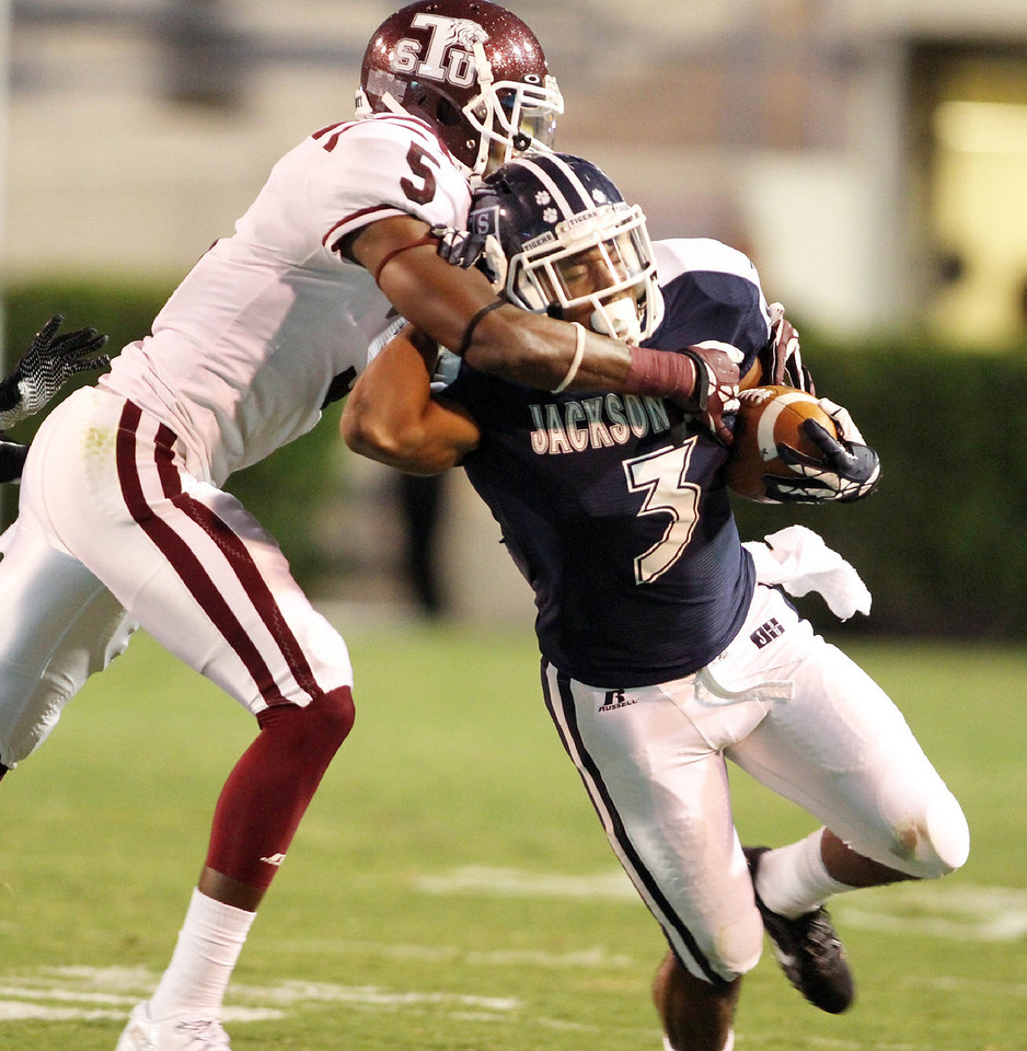 Jarius Moore attempts to run past a Texas Southern defender.