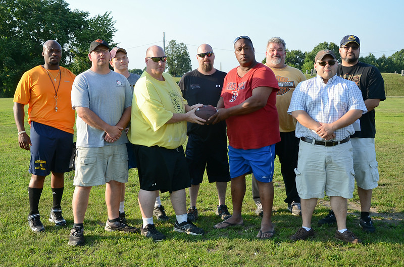 The Central Mass. Sabercats coaching staff. Back row, from left: Orlando Jones, Paul Anciello, Jason Andrews (center), Brian Nash, Tom Bradshaw. Front row, from left: Eric Johnston, Bill Nash, Head Coach Tim Wilson, and Jason Desrosiers. SENTINEL & ENTERPRISE / Ashley Green