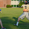 Tyler Hood passes to a teammate during Central Mass. Sabercats adult football practice at St. Bernard's Elementary School on Tuesday evening. SENTINEL & ENTERPRISE / Ashley Green