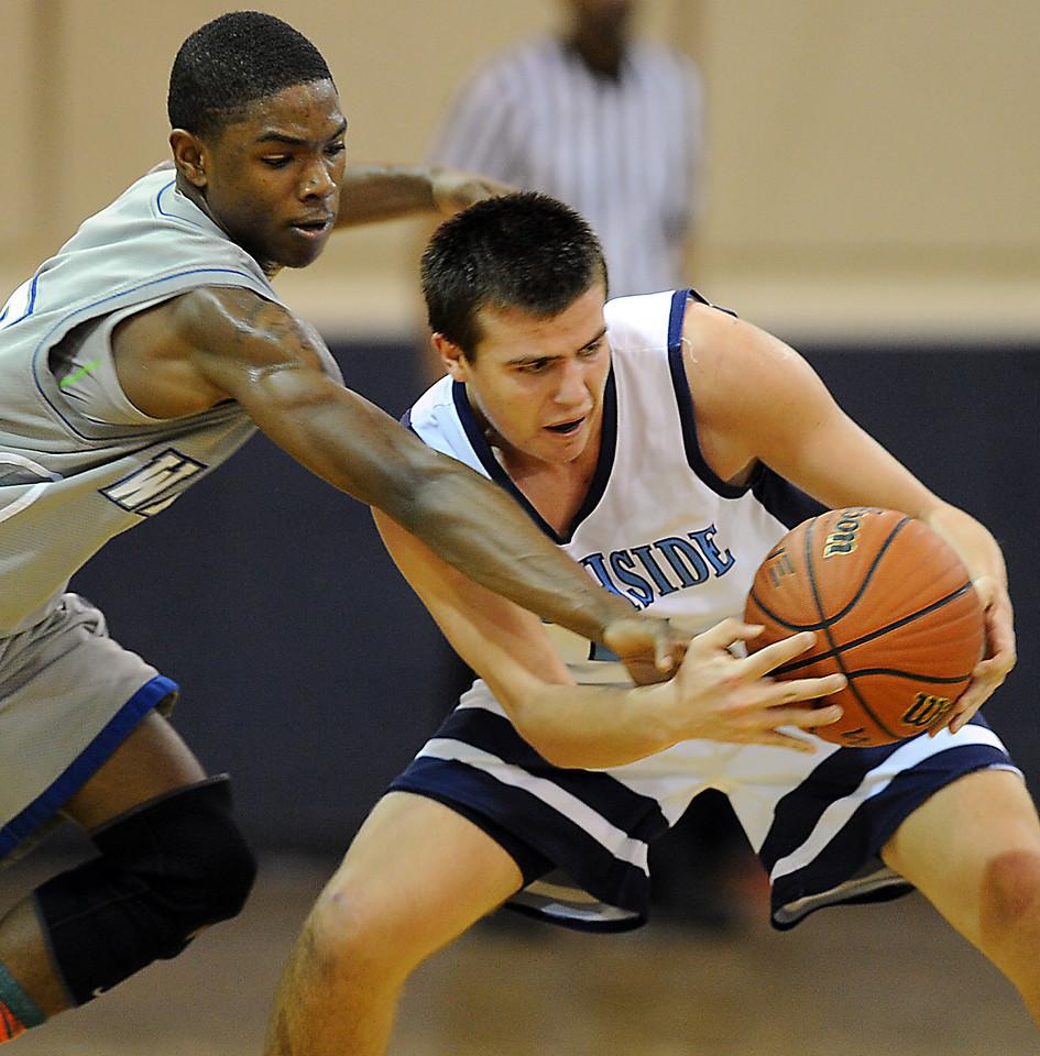 The Southside Christian Sabres played host to the Greenville Tech Charter Warriors in a basketball game.<br /> GWINN DAVIS PHOTOS<br /> gwinndavisphotos.com (website)<br /> (864) 915-0411 (cell)<br /> gwinndavis@gmail.com  (e-mail) <br /> Gwinn Davis (FaceBook)