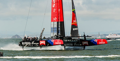 Team NZ heads back to their dock after race six is postponed .