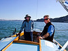 "Left, Joan Wheeler, lady friend of Ron Young; right, Ron Young - Sailing on San Francisco Bay on Ron Young's classic wooden boat ""Youngster"""