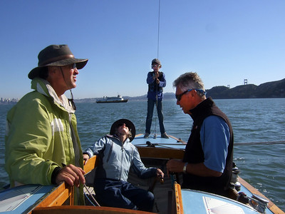"Left, Marc Lambros; 2nd left, Joan Wheeler, lady friend of Ron Young; 3rd left, Silas, Marc's son; Right, Ron Young - Sailing on San Francisco Bay on Ron Young's classic wooden boat ""Youngster"""