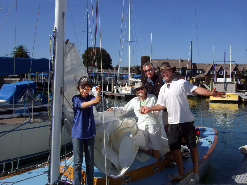 "Left, Marc Lambros' son; Lady friend of Ron's; 3rd on left, Ron Young; right, Marc Lambros - Sailing on San Francisco Bay on Ron Young's classic wooden boat ""Youngster"""