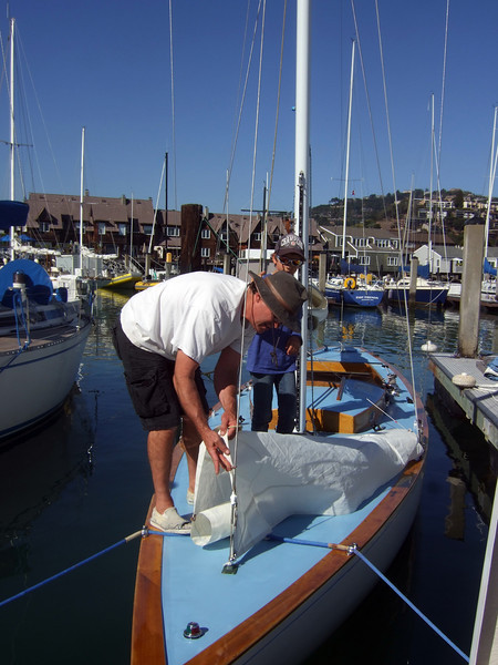 "Marc Lambros and son Silas, setting sails - Sailing on San Francisco Bay on Ron Young's classic wooden boat ""Youngster"""
