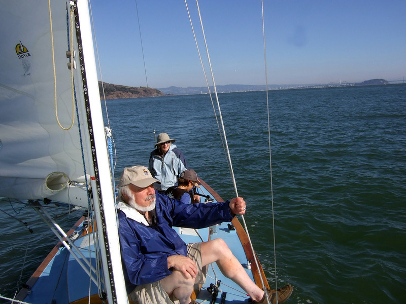 """Front, Stephen Somerstein; Middle, Silas, Marc Lambros' son; Far, Ron Young's lady friend Joan Wheeler - Sailing on San Francisco Bay on Ron Young's classic wooden boat """"Youngster"""""""