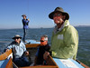 """Left, Marc Lambros; 2nd left, Joan Wheeler, lady friend of Ron Young; 3rd left, Silas, Marc's son; Right, Ron Young - Sailing on San Francisco Bay on Ron Young's classic wooden boat """"Youngster"""""""