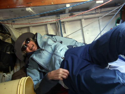 "Ron's lady friend Joan Wheeler ""relaxing"" below decks - Sailing on San Francisco Bay on Ron Young's classic wooden boat ""Youngster"""