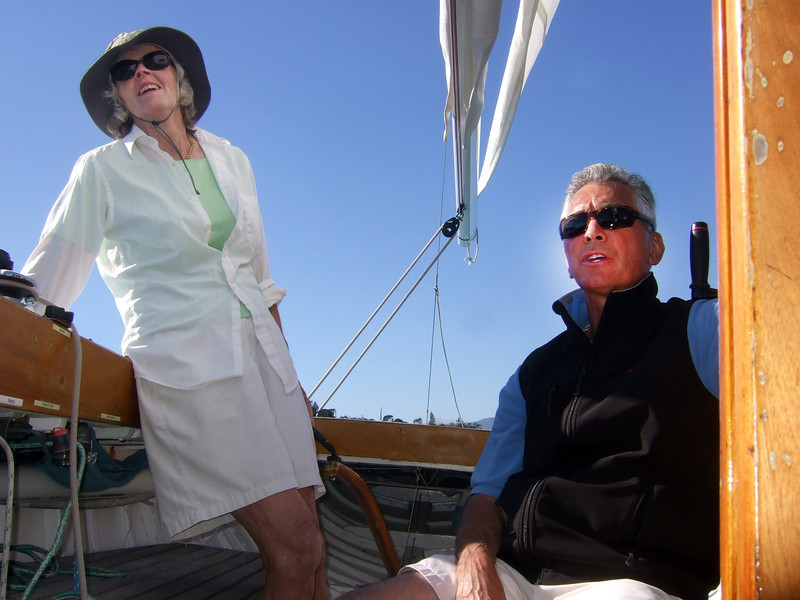"Ron Young and lady friend Joan Wheeler from Marblehead, Massachusetts - Sailing on San Francisco Bay on Ron Young's classic wooden boat ""Youngster"""