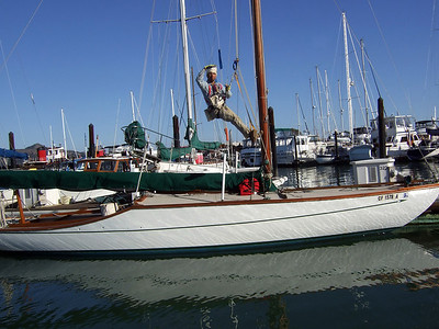 "Man in sling on sailboat - Sailing on San Francisco Bay on Ron Young's classic wooden boat ""Youngster"""