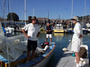 """Marc Lambros, son and lady friend of Ron Young - Sailing on San Francisco Bay on Ron Young's classic wooden boat """"Youngster"""""""