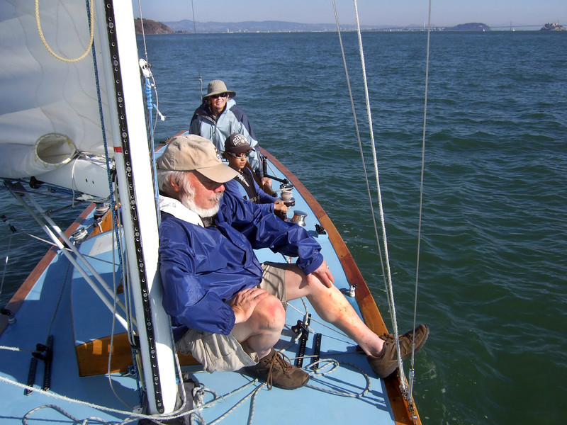 "Front, Stephen Somerstein; Middle, Silas, Marc Lambros' son; Far, Ron Young's lady friend Joan Wheeler - Sailing on San Francisco Bay on Ron Young's classic wooden boat ""Youngster"""