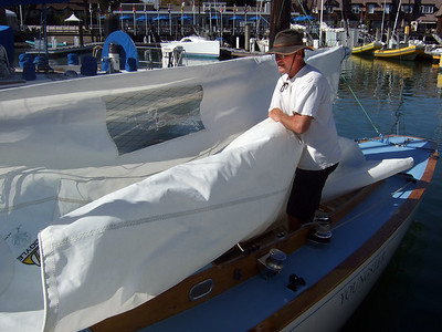 """Marc Lambros setting sails - Sailing on San Francisco Bay on Ron Young's classic wooden boat """"Youngster"""""""