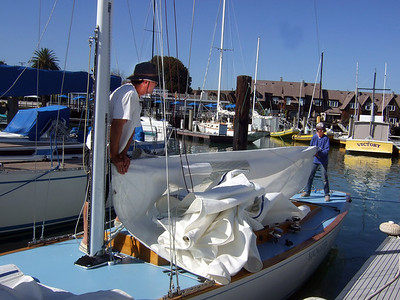 "Marc Lambros and son setting sails - Sailing on San Francisco Bay on Ron Young's classic wooden boat ""Youngster"""